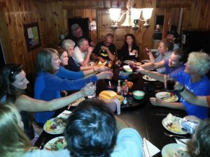 Guests of the Rattle River (White Mountains) Lodge and Hostel gathering for a feast.